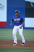 Dominic Smith (22) of the Las Vegas 51s leads off of second base during a game against the Sacramento River Cats at Cashman Field on June 15, 2017 in Las Vegas, Nevada. Las Vegas defeated Sacramento, 12-4. (Larry Goren/Four Seam Images)