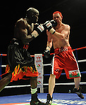 Hari Miles ( Red with Black stripe ) V Nick Okoth (Black flame shorts)Joe Calzaghe Promotions Boxing Evening .Date: Friday 20/11/2009,  .© Ian Cook IJC Photography, 07599826381, iancook@ijcphotography.co.uk,  www.ijcphotography.co.uk, .