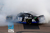 #18: Kyle Busch, Joe Gibbs Racing, Toyota Supra Extreme Concepts/iK9 celebrates his win with a burnout