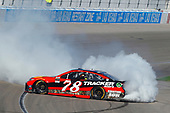 2017 Monster Energy NASCAR Cup Series - Kobalt 400<br /> Las Vegas Motor Speedway - Las Vegas, NV USA<br /> Sunday 12 March 2017<br /> Martin Truex Jr, Bass Pro Shops/TRACKER BOATS Toyota Camry celebrates his win with a burnout <br /> World Copyright: Russell LaBounty/LAT Images<br /> ref: Digital Image 17LAS1rl_5175