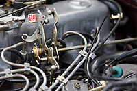 The stop engine switch inside the engine bay of the 1979 Mercedes W123 300 Turbo Diesel from Missouri in the USA, at Gliffaes Hotel near Abergavenny, Wales, UK. Friday 24 August 2019
