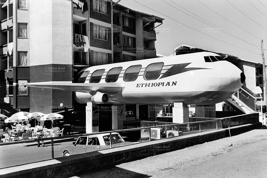 Ethiopia. Addis Ababa is the capital city and the name of a region of Ethiopia. A derelict airplane from the airline company Ethiopian Airlines has been recycled into a cafe and restaurant. © 2001  Didier Ruef