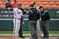 Head coach Monte Lee (18) of the Clemson University Tigers confers with the umpires before a game against the Wofford College Terriers on Tuesday, March 1, 2016, at Doug Kingsmore Stadium in Clemson, South Carolina. Clemson won, 7-0. (Tom Priddy/Four Seam Images)