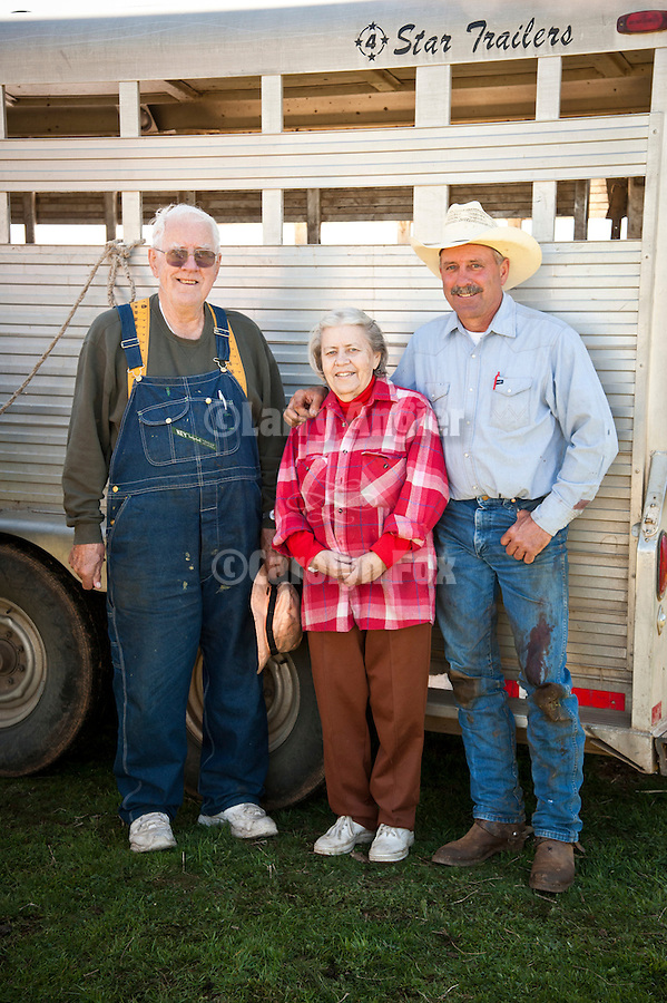 Frank Sr. and Maryanne Busi with their son Frank Jr. during calf marking and branding at the Stoney Creek Corrals of the Busi Ranch, Amador County, Calif.