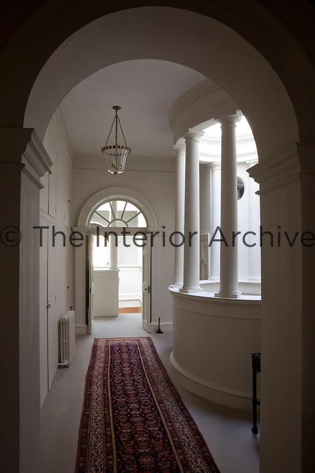 A corridor leading past the palladian atrium