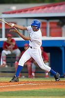 Burlington third baseman Antonio Jimenez (15) follows through on his swing versus Johnson City at Burlington Athletic Park in Burlington, NC, Saturday, August 25, 2007.