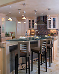 A contemporary Richmond kitchen featuring a vibrant mix of materials, colors, and textures.