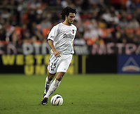 30 October,  2004.   Gilberto Flores (25) of the MetroStars brings the ball upfield during the 2004 MLS playoffs at RFK Stadium in Washington, DC.
