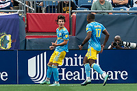 FOXBOROUGH, MA - AUGUST 8: Paxten Aaronson #30 of Philadelphia Union celebrates his goal with teammates during a game between Philadelphia Union and New England Revolution at Gillette Stadium on August 8, 2021 in Foxborough, Massachusetts.