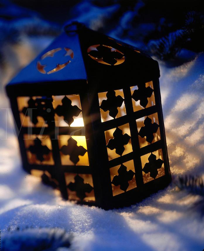 Steel Lantern glowing in the snow.