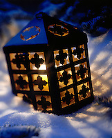 Steel Lantern glowing in the snow.