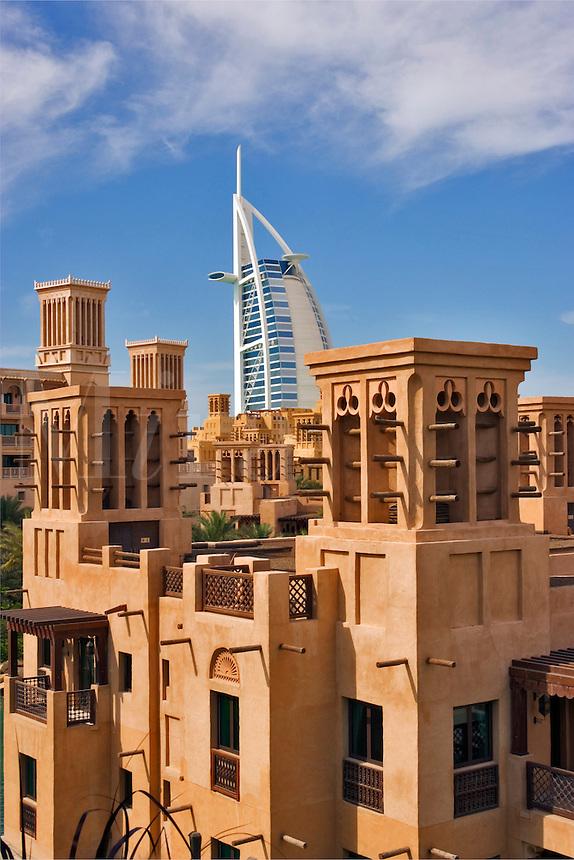 View over Al Qasr Hotel villas and Madinat Jumeirah souk towards Burj Al Arab and Mina a?Salam Hotel.  Dubai. United Arab Emirates.