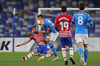 Antonio Puertas of Granada CF and Amir Rrahmani of SSC Napoli compete for the ball during the Europa League round of 32, 2nd leg football match between SSC Napoli and Granada CF at Diego Armando Maradona stadium in Napoli (Italy), February 25, 2021.<br /> Photo Cesare Purini / Insidefoto
