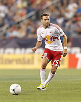New York Red Bulls defender Brandon Barklage (25) passes the ball. In a Major League Soccer (MLS) match, New England Revolution defeated New York Red Bulls, 2-0, at Gillette Stadium on July 8, 2012.