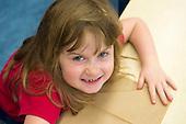 MR / Schenectady, NY. Zoller Elementary School (urban public school). Kindergarten classroom. Girl (6) makes funny face. MR: Bin1. ID: AM-gKw. © Ellen B. Senisi.