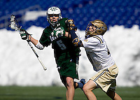 Josh Hawkins (5) of Loyola is checked by Jaren Woeppel (45) of Navy at the Navy-Marine Corp Memorial Stadium in Annapolis, Maryland.   Loyola defeated Navy, 8-7, in overtime.