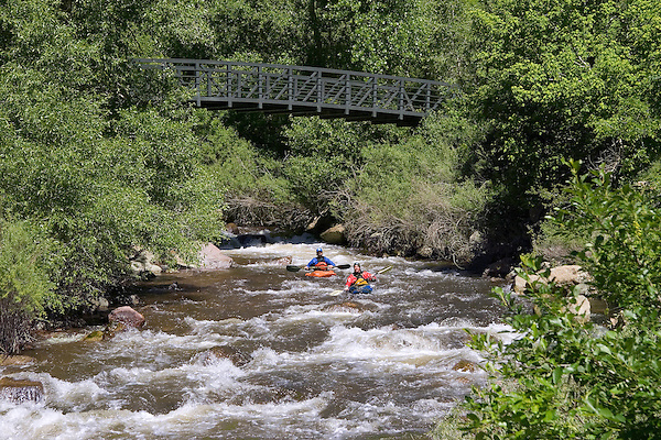 Kayakers on Boulder Creek, Boulder, Colorado, John offers private photo tours of Boulder, Denver and Rocky Mountain National Park. .  John offers private photo tours in Denver, Boulder and throughout Colorado. Year-round.