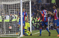 Fraizer Campbell of Crystal Palace celebrates his goal with Emmanuel Adebayor (25) & Wilfried Zaha of Crystal Palace of Crystal Palace during the FA Cup quarter-final match between Reading and Crystal Palace at the Madejski Stadium, Reading, England on 11 March 2016. Photo by Andy Rowland/PRiME Media Images.