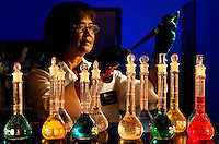 An employee of Microban International Ltd. in Huntersville, NC, (north of Charlotte, NC) examines graduated cylinders and other laboratory equipment with sample extracts containing antimicrobials. Antimicrobials kill or inhibit the growth of microorganisms, such as fungi, bacteria or protozoans. Microban is a global leader in built-in antimicrobial product protection. The company engineers durable antimicrobial solutions for consumer, industrial and medical products worldwide. Microban was founded in 1994 by three biomedical engineers, who use proprietary processes to engineer antimicrobial ingredients into solid products. Now an international company, Microban develops antimicrobial solutions that give consumer, industrial and medical products an added level of protection against damaging microbes such as bacteria, mold and mildew that can cause stains, odors and product deterioration.