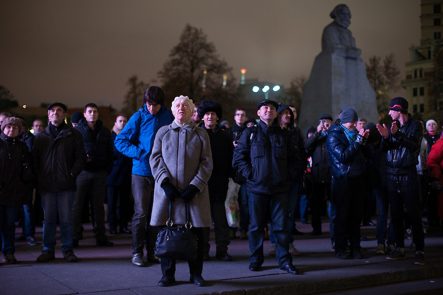 Moscow, Russia, 28/10/2011..Crowds on on Ploschad Revolutsii opposite the Bolshoi Theatre watch the theatre's gala reopening night on giant outdoor video screens. The theatre had been closed since 2005 for reconstruction work that cost some $700 million.