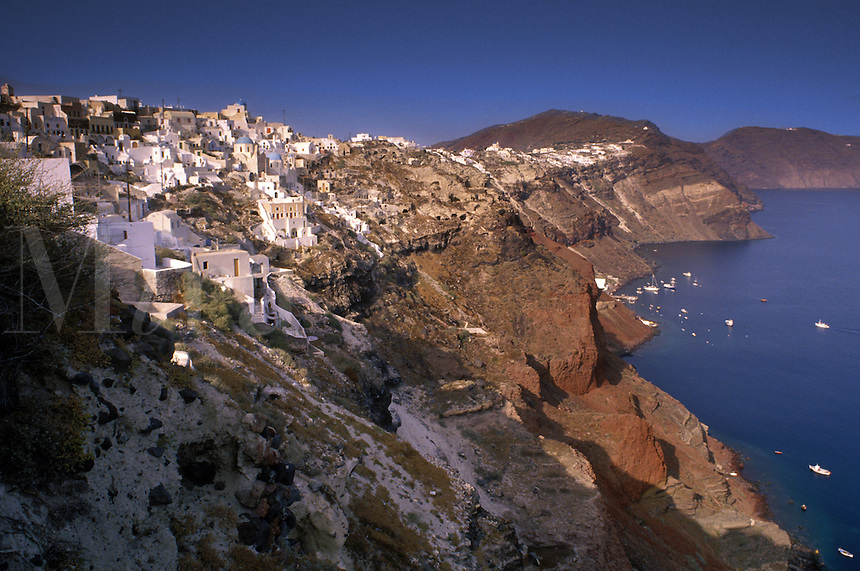 The precipitous west coast of Santorini (also known as Thira), a popular Greek island in the Mediterranean.  This west coast is viewed by many as the inner wall of a huge volcanic caldera.
