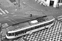 A man runs to catch the tram at Koningin Astridplein, Antwerp, Belgium