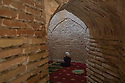 Uzbekistan - Tashkent - A muslim woman prays inside the Zayniddin Bobo Mausoleum, built in the 16th century.