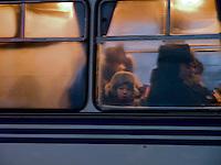 Boy sitting behind a window of a Yakutsk bus.