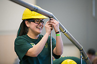 UAA College of Engineering build team member Shoshanna Johnson participates in a bridge-building demo at the send-off for the American Institute of Steel Construction (AISC) Steel Bridge Competition in the UAA Engineering and Industry Building Structures Lab.