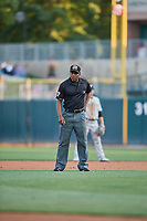 Third base umpire Malachi Moore handles the calls on the bases during the game between the Salt Lake Bees and the El Paso Chihuahuas at Smith's Ballpark on August 14, 2018 in Salt Lake City, Utah. El Paso defeated Salt Lake 6-3. (Stephen Smith/Four Seam Images)