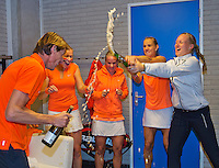 Februari 08, 2015, Apeldoorn, Omnisport, Fed Cup, Netherlands-Slovakia, The winning Dutch team celebrate with champagne,.tlrl:  Captain Paul Haarhuis, Michaella Krajicek, Richel Hogenkamp, Arantxa Rus, ,and  Kiki Bertens <br /> <br /> Photo: Tennisimages/Henk Koster