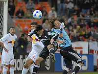 Alecko Eskandarian (11) heads the ball after goalkeeper Jon Conway (18) came out to make a save on a corner kick. DC United tied the New York Red Bulls 1-1 and won on a 2-1 aggregate in their Eastern Conference Semifinals series on Sunday, November 29, 2006 at RFK Stadium.