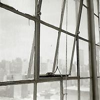 Midtown Manhattan through partially opened square windows<br />