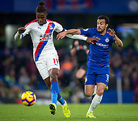 Wilfried Zaha of Crystal Palace & PEDRO of Chelsea during the Premier League match between Chelsea and Crystal Palace at Stamford Bridge, London, England on 4 November 2018. Photo by Andy Rowland.<br /> .<br /> (Photograph May Only Be Used For Newspaper And/Or Magazine Editorial Purposes. www.football-dataco.com)