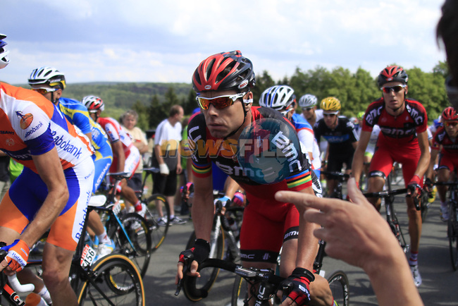 The peloton including Defending Champion Cadel Evans (AUS) BMC Racing Team climbs the Cote De Barvaux during Stage 1 of the 99th edition of the Tour de France, running 198km from Liege to Seraing, Belgium. 1st July 2012.<br /> (Photo by Eoin Clarke/NEWSFILE)