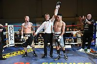 Adam Dempsey (grey shorts) defeats Fonz Alexander during a Boxing Show at the Corn Exchange on 25th September 2021