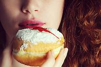 Hanukkah donuts with beautiful natural look model<br /> Closeup on lips and doughnut