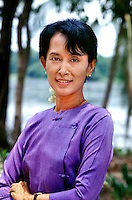 Yangon, Burma/Myanmar 1996 <br /> Aung San Suu Kyi, Democratic leader of Burma, political prisoner & 1991 Nobel Peace Prize recipient  <br /> Although the politics of Burma have stabilized somewhat in recent years, the Burmese military refused to recognize the elections won by Aung San Suu Kyi and her National League for Democracy (NLD) in 1990, instead seizing all power and placing her under house arrest for 15 years. While still imprisoned, she was awarded the Nobel Peace Prize in 1991 and was cited by the Nobel Committee as one of the most extraordinary examples of civil courage in Asia in recent decades. <br /> I was able to meet Aung San Suu Kyi shortly after she was initially freed from house arrest for a short period and was deeply impressed by her dignity and inner strength during her ongoing struggle for democracy. This day was the first time in six years she had been able to leave her house for the New Year and the NLD members swarmed her front lawn in joyous celebration