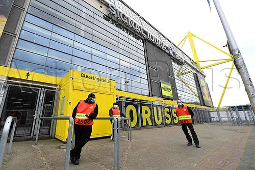 16th May 2020, Signal Iduna Park, Dortmund, Germany; Bundesliga football, Borussia Dortmund versus FC Schalke;  Stewards with protective masks standing in front of the Signal Iduna Park in Dortmund