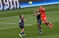Washington Freedom's Abby Wambach leaps high over LA Sol's Stephanie Cox. The LA Sol defeated the Washington Freedom 2-0 in the opening game of Womens Professional Soccer at Home Depot Center stadium on Sunday March 29, 2009.  .Photo by Michael Janosz