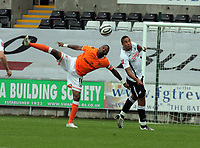ATTENTION SPORTS PICTURE DESK<br /> Pictured: Ashley Williams of Swansea (R) heads the ball away, against Hamuer Bouazza of Blackpool (L)<br /> Re: Coca Cola Championship, Swansea City Football Club v Blackpool at the Liberty Stadium, Swansea, south Wales. Saturday 24 October 2009