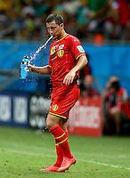 Eden Hazard of Belgium spits out water