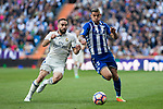 Daniel Carvajal of Real Madrid competes for the ball with Theo Hernandez of Club Deportivo Alaves during the match of  La Liga between Real Madrid and Deportivo Alaves at Bernabeu Stadium Stadium  in Madrid, Spain. April 02, 2017. (ALTERPHOTOS / Rodrigo Jimenez)
