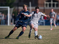 Jimmy Nealis (16) of Georgetown collides with Patrick Wallen (10) of San Diego during the game at North Kehoe Field in Washington, DC.  Georgetown defeated San Diego, 3-1.