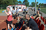 """Polish soldiers sit on the sidelines as the American soldiers arrive during a day off for cultural activities, which included sports games between the different participating armies in the NATO """"Saber Strike"""" military exercises, in Drawsko Pomorskie, Poland on June 13, 2015.  NATO is engaged in a multilateral training exercise """"Saber Strike,"""" the first time Poland has hosted such war games, involving the militaries of Canada, Denmark, Germany, Poland, and the United States."""