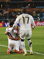 Landon Donovan celebrates the match's final whistle with Clint Dempsey.The United States won Group C of the 2010 FIFA World Cup in dramatic fashion, 1-0, over Algeria in Pretoria's Loftus Versfeld Stadium, Wednesday, June 23rd..