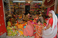 The Blue City, Jodhpur Rajasthan India. Women shopping for Saris