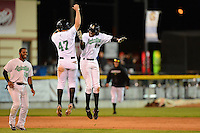 Clinton LumberKings outfielder Gaby Guerrero #27 and Patrick Kivlehan #47 celebrate a walk off hit by Guerrero as Guillermo Pimentel #18 looks on during a game against the Burlington Bees on May 23, 2013 at Ashford University Field in Clinton, Iowa.  Clinton defeated Burlington 6-5.  (Mike Janes/Four Seam Images)