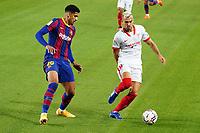 4th October 2020; Camp Nou, Barcelona, Catalonia, Spain; La Liga Football, Barcelona versus Sevilla;  Jordan of Sevilla turns away on the ball from Araújo of Barca