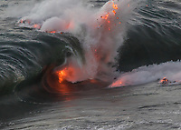 Lava Wave: Lava explodes at the top of a curling wave; submarine lava flows make their way to the surface, Kamokuna, Hawai'i Volcanoes National Park, Hawai'i Island.